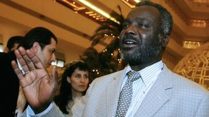 Sudanese rebel Justice and Equality Movement (Jem) representative Gibril Ibrahim waving at the lobby of his hotel in the Qatari capital Doha on 13 February 2009 where representatives of the Darfur rebel group and a Sudanese government delegation were holding face to face talks