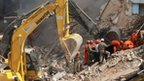 Rescue teams work in debris of Rio de Janeiro building collapse