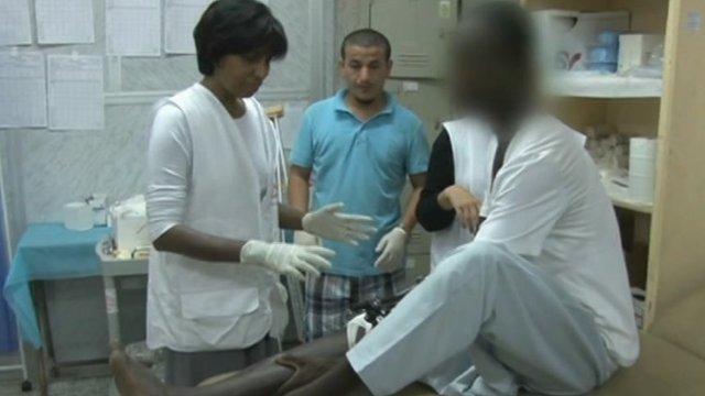 Medecins Sans Frontieres medics treating injured Libyan patient
