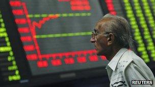 A trader at the Karachi Stock Exchange