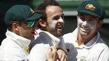 Michael Clarke, Nathan Lyon and Shaun Marsh celebrate a wicket