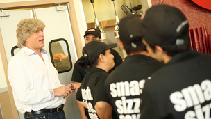 Tom Ryan addressing staff in a Smashburger branch