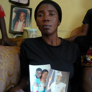 Paulina Yusuf holds pictures of her sons