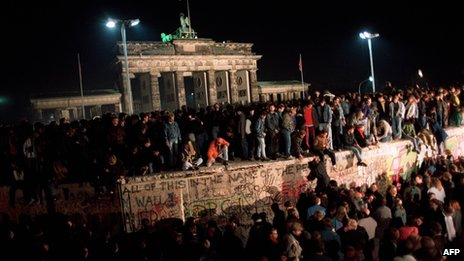 East Berliners climbing onto the Berlin wall in 1989