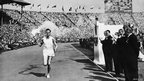 John Mark runs with the torch to light the Olympic cauldron on 29 July 1948
