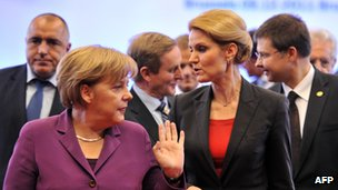 Germany's Chancellor Angela Merkel (left) and Danish PM Helle Thorning-Schmidt in Brussels, 9 Dec 11