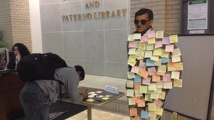 A cardboard cut out of Joe Paterno cover in post-its