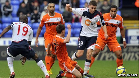 Swansea City&#039;s Josh McEachran battles for the ball with Bolton&#039;s Joe Riley