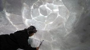 A man makes an Igloo