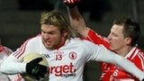 Owen Mulligan is challenged by Derry's Brian McCallion in this year's decider
