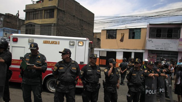Police officers stand guard outside the rehabilitation centre in Lima