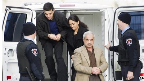 Mohammad Shafia (front), Tooba Yahya (centre), and their son Hamed Shafia arriving at court in Kingston, Ontario (28 January)