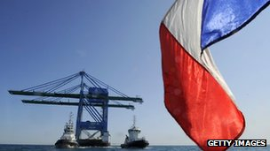 French flag in front of oil rig