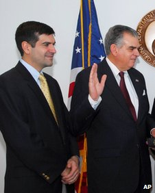 Sam Lahood, left, watches as his father Ray is sworn in as Transportation Secretary in January 2009