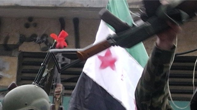 Rifle and and Syrian flag