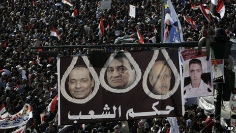"Banner reading ""Rule of the People"" at a demonstration in Tahrir Square (25 January 2012)"