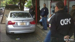 Police inspect the Mexican ambassador's car in Caracas