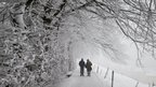 Strollers make their way on a snowy country lane near St Gallen, Switzerland, 29 January 2012