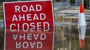Flooded road with closed sign