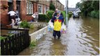 Morpeth residents leaving flooded homes in 2008. Photo: PA