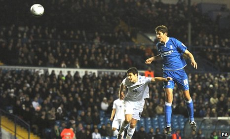 Nikola Zigic scores against Leeds