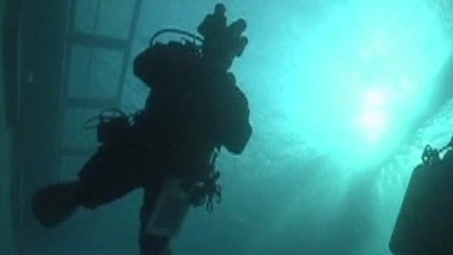 Diver in waters around Costa Concordia
