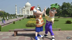 Disney cartoon characters Phineas and Ferb pose in front of The Taj Mahal