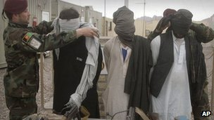 Afghan soldiers display detained Taliban militants to the news media in Herat, west of Kabul, Afghanistan, on 29 January 2012