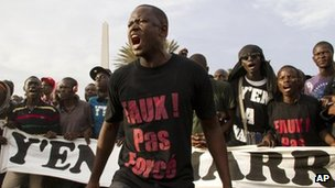 Protesters opposed to President Abdoulaye Wade running for a third term shout slogans during a rally in Dakar, Senegal Tuesday 31 January 2012