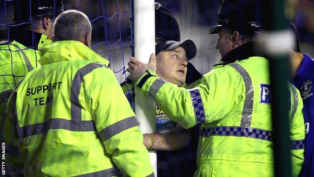 A spectator handcuffs himself to a goalpost during Everton&#039;s match with Manchester City at Goodison Park