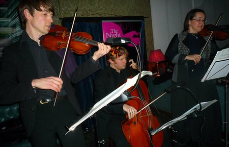 orchestra playing in a pub
