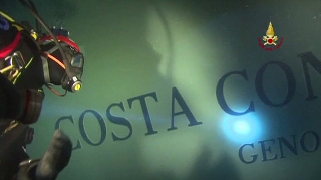 Diver inspects Costa Concordia hull
