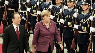 German Chancellor Angela Merkel and Chinese Premier Wen Jiabao review a guard of honour at the Great Hall of the People in Beijing, China, on Thursday