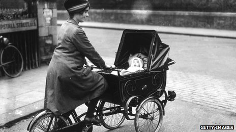 Woman on bicycle pram in 1920s