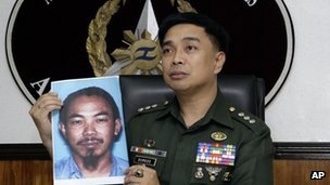 Armed Forces of the Philippines spokesman Col. Marcelo Burgos shows a picture of Malaysian Zulkipli bin Hir, also known as Marwan, a top leader of the regional, al Qaida-linked Jemaah Islamiyah terror network, during a press conference Thursday, Feb. 2, 2012 in suburban Quezon City, north of Manila, Philippines.