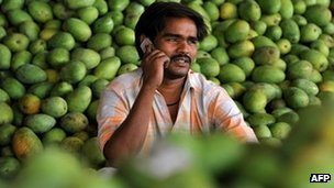 An Indian farmer talking on his mobile phone