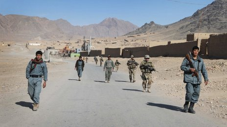 Afghan policemen walk ahead of the U.S. soldiers with the NATO- led International Security Assistance Force (ISAF) during a foot patrol in Kandahar, south of Kabul, Afghanistan, in this Jan. 7, 2012