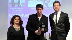 Peter Straughan (centre) with his Rafa award, flanked by awards hosts Hilary Oliver and James King