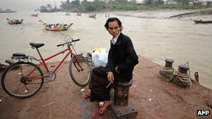 Burmese man waits to cross river near Rangoon