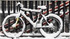 A bicycle is covered by snow in central Milan, Italy (Thursday, Feb. 2, 2012)