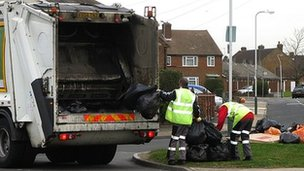 Bin men collecting rubbish in Rainham, Essex