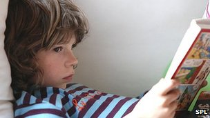 Generic image of boy reading book