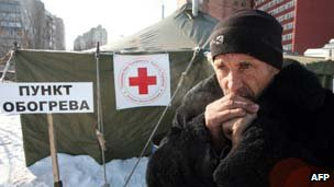 Homeless man stands outside shelter in Donetsk, Ukraine on 2 February 2012