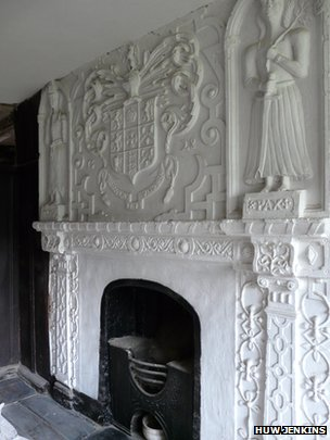 Decorative plaster work above the fireplace at Plas Tirion