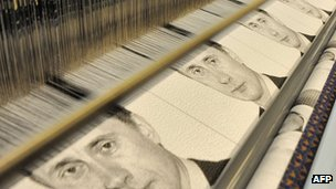 Images of Vladimir Putin are woven on a loom near St Petersburg