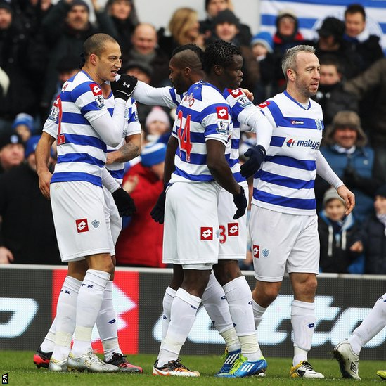QPR players celebrate after scoring