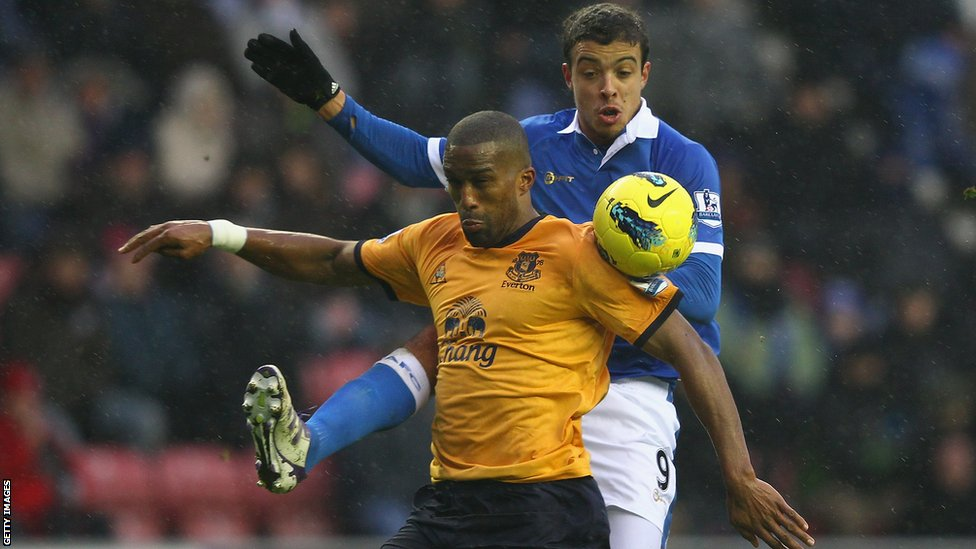 Sylvain Distin and Franco di Santo challenge for the ball