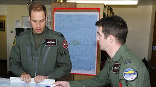 Prince William looking at map with colleague