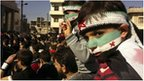 Demonstrators protest against Syria's President Bashar al-Assad in Binsh near Idlib February 3