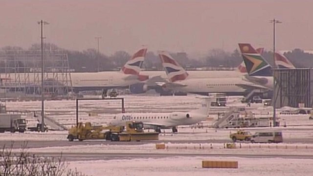 Planes at a snowy Heathrow